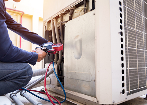 Technician is Checking Air Conditioner Measuring Equipment Filling Air Conditioners